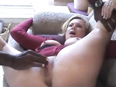 Horny white milf and a hotwife with a huge breast blows black nigga dick and takes it from behind on sofa as her cuckold husband films. Hot amateur homemade cheating porn but the one bad thing that he uses condom but removes it in the end to give his slut a good portion of cum in her mouth.